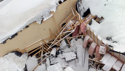Collapsed roof from heavy snow - Boynton & Boynton Insurance